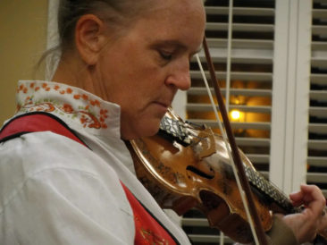 A closeup of Gulf Coast Viking member and Hardanger fiddler Karen Solgard