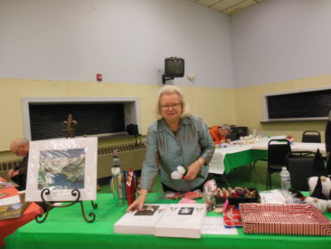 Maine Nordmenn lodge secretary Cheryl Lunde sells crafts she made during Juletrefest