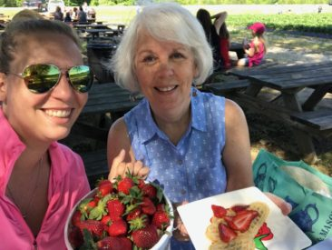 Norskevenner lodge members BeccaVanDeventer and Elizabeth Schupp enjoying strawberries and waffles during their Strawberry Festival!