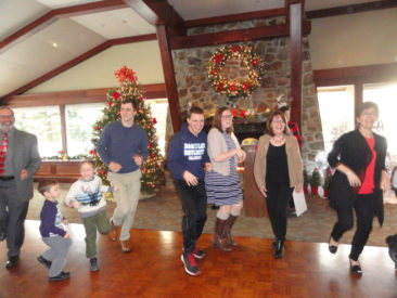 Restauration Lodge enjoying themselves while dancing around the Christmas tree at their 2017 Christmas party